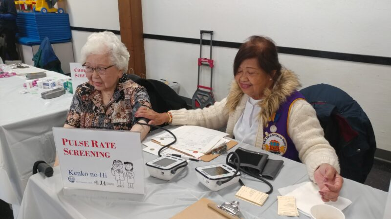 women at clinic table